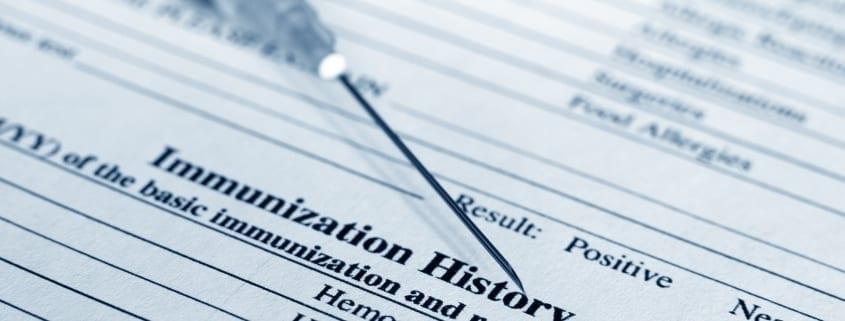 Immunization syringe on top of immunization history.
